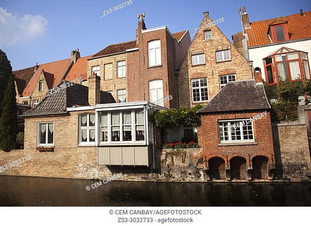 Traditional houses on the canal in the city center, Bruges, West Flanders, Belgium, Europe