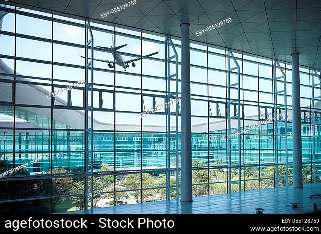 modern airport window scene with airplane