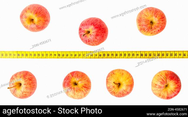 Apple diet, red apples with a yellow tape-measure
