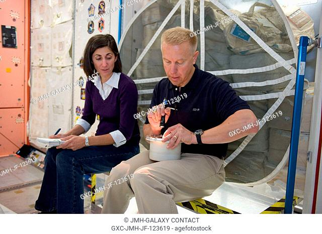 Astronauts Nicole Stott, Expedition 2021 flight engineer, and Tim Kopra, Expedition 1920 flight engineer, participate in a training session in an International...