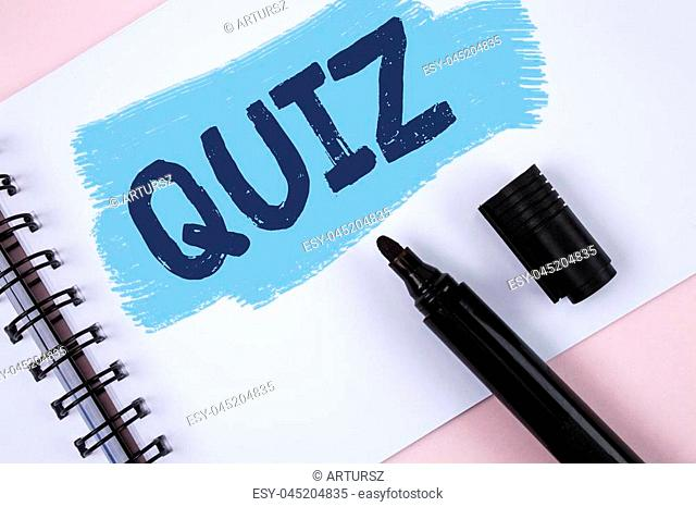 Text sign showing Quiz. Conceptual photo Short Tests Evaluation Examination to quantify your knowledge written Painted Notepad plain Pink background Marker next...