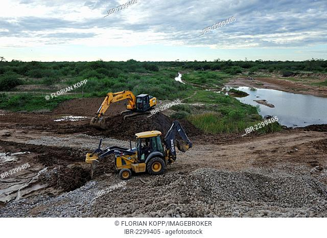 Construction works at a controversial road through the floodplains of the Pilcomayo River, a project supported by the Inter-American Development Bank, IDB