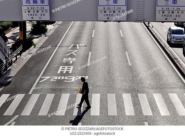 Naha, Okinawa, Japan: a pedestrian crossing the Route 58
