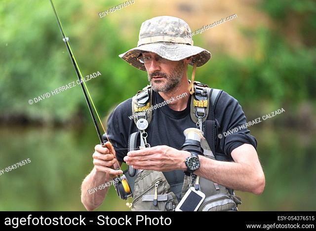 Pro fishermen with fishing rod, hobby and sport activity