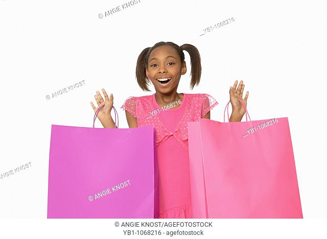 Ten year old girl with shopping bags