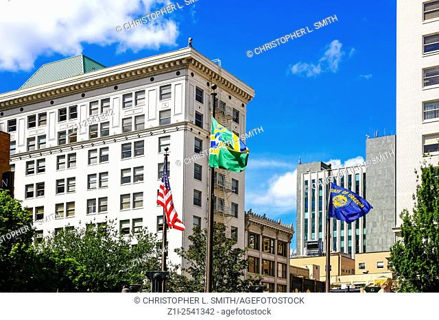 Portland City flag, Oregon State flag and the National American flag in Pioneer Courthouse Square, Portland