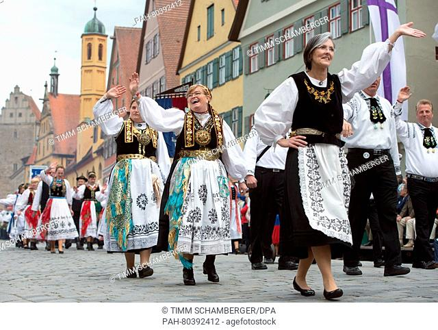 A group in traditional costume moves through the city during the Transylvanian Saxons Pentecost meeting in Dinkelsbuehl, Germany, 15 May 2016