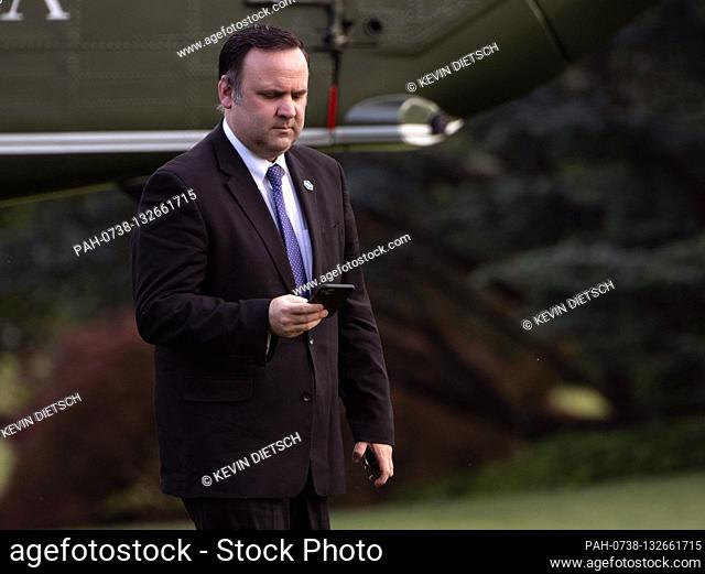Dan Scavino, White House Deputy Chief of Staff for Communications, looks at his phone as he returns to the White House with President Donald Trump and First...