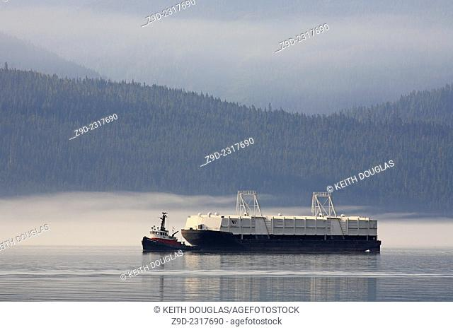 Tugboat and bulk cargo barge heading for Alcan aluminum smelter, Kitimat, British Columbia