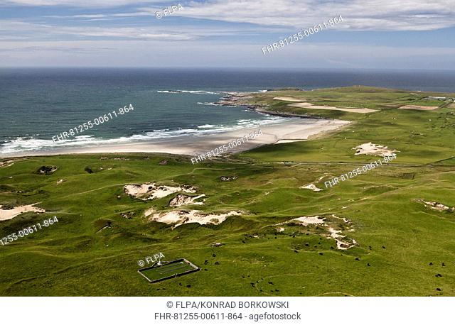 Aerial view of coastline with military cemetery, vegetated coastal dune habitat and beach, Kilchoman Military Cemetery, Machir Bay, Isle of Islay