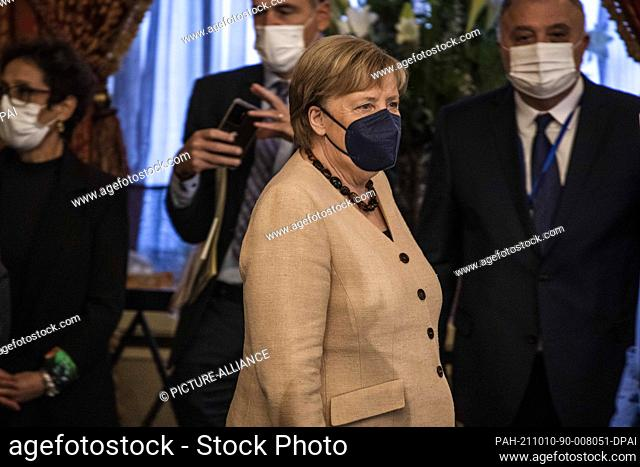 10 October 2021, Israel, Jerusalem: German Chancellor Angela Merkel (C)arrives to attend the weekly Israeli Cabinet meeting as part of her two-day visit to...