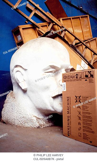 Lenin statue hidden behind boxes in a warehouse, Moscow, Russia