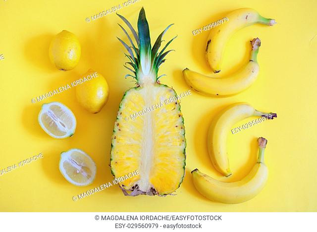 Fruits from above on yellow background