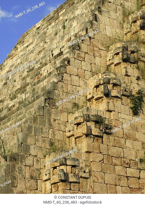 Low angle view of sculptures of god Chac on a pyramid, Pyramid Of The Magician, Uxmal, Yucatan, Mexico