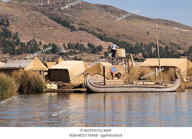 Peru, Lake Titicaca. Quechua or Uros Indian village on the floating Uros Islands