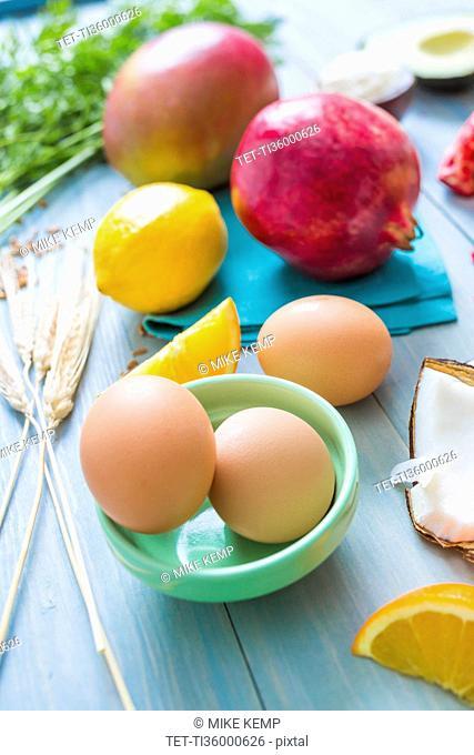 Eggs, oranges and pomegranates