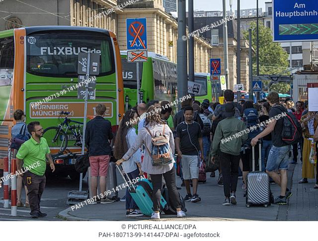 13 July 2018, Germany, Frankfurt: Thick crowds dominating at the Flix bus boarding area at the central station. There are constant chaotic transport scences at...