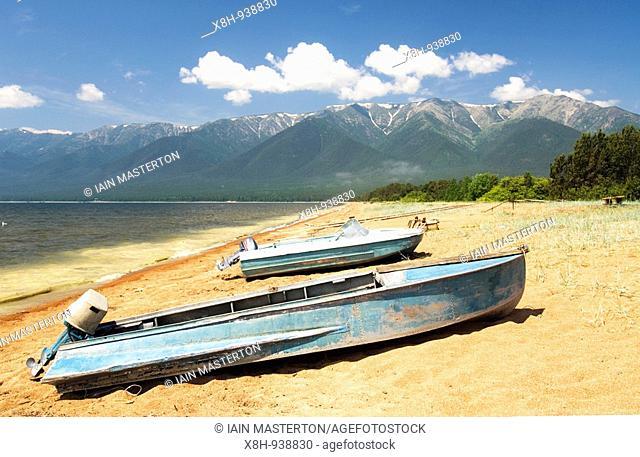 Boat on shores of Lake Baikal in Zaibaikal National Park in Siberia Russia