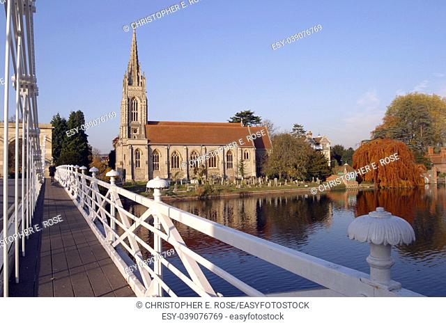 England, Chilterns, Buckinghamshire, the church and historic suspension bridge over the River Thames at Marlow