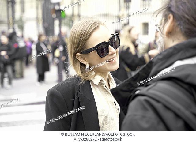 fashionable woman talking to man at street during fashion week, in Paris, France