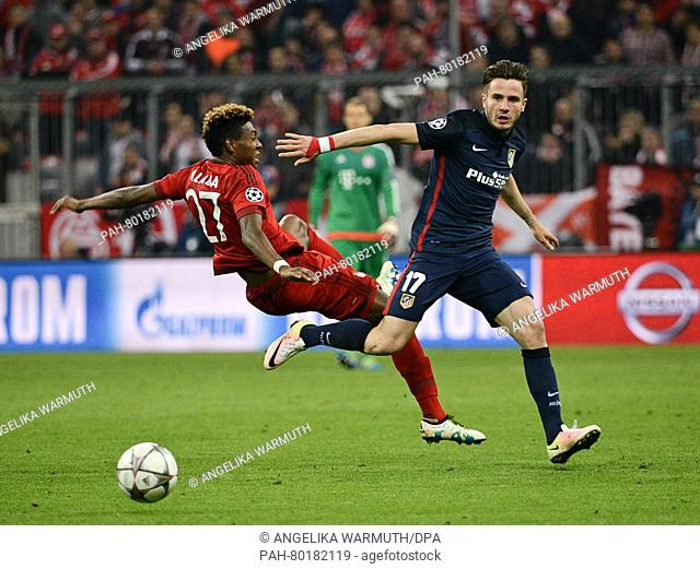 Munich's David Alaba (L) in action against Madrid's Saul Niguez during the UEFAChampions League semi final second leg soccer match between Bayern Munich and...