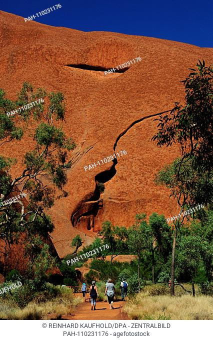Impressive rock formation of the Uluru (Ayers Rock) with caves and columns in the Uluru Kata Tjuta National Park in Australia - the Uluru is the second largest...