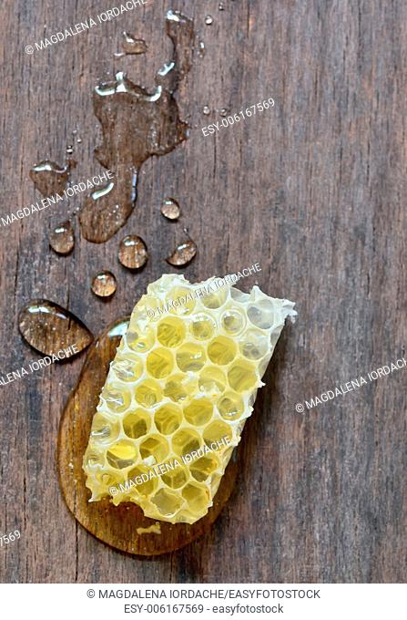 sweet honeycombs with honey isolated on old wooden background
