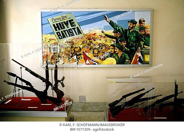 Picture of the revolution with Fidel Castro, guns in show cases, Museo de la Revolución, Centro Habana, Havana, Cuba, Caribbean