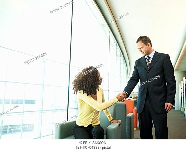 Man and woman greeting in lobby