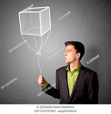Young man holding balloon drawing Stock Photos and Images   age