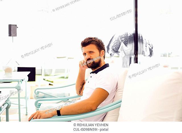 Man relaxing on terrace chair