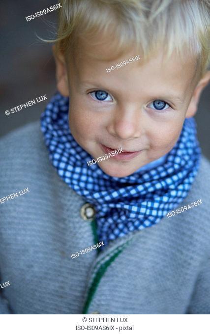 Portrait of cute boy with blue eyes