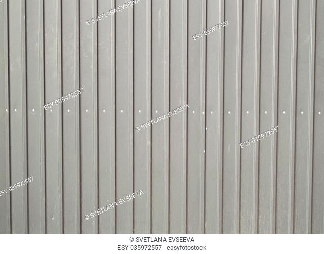 The background texture of gray metal siding to finish the outside