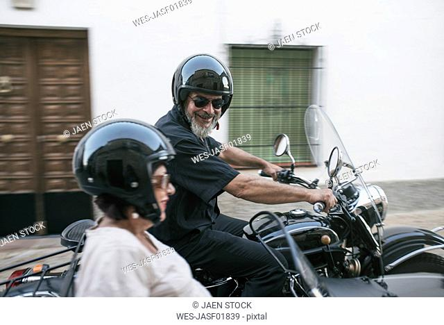 Spain, Jaen, mature couple on a trip with motorcycle with a sidecar