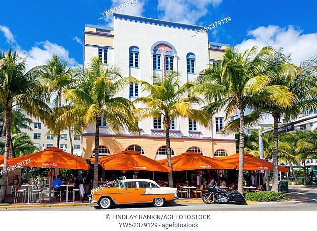 Art Deco building design on Ocean Drive, South Beach Miami, Florida, USA with a cafe restaurant below