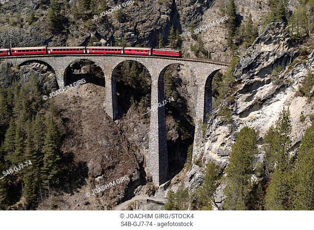 The Glacier Express crossing a bridge, Filisur, Graubuenden, Switzerland