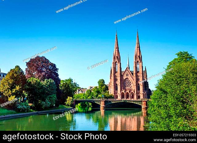 Panoramic view of the Ill river embankment with Saint Paul Church and Pont d'Auvergne in Strasbourg, France