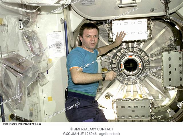 Cosmonaut Yuri P. Gidzenko, Expedition One Soyuz commander, stands near the hatch leading from the Unity node into the newly attached Destiny laboratory aboard...
