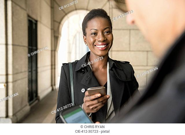 Corporate businessman and businesswoman with cell phones