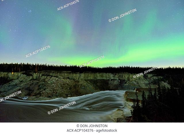 Aurora borealis (Northern Lights) over Louise Falls gorge, Twin Falls Territorial Park, Northwest Territories, Canada