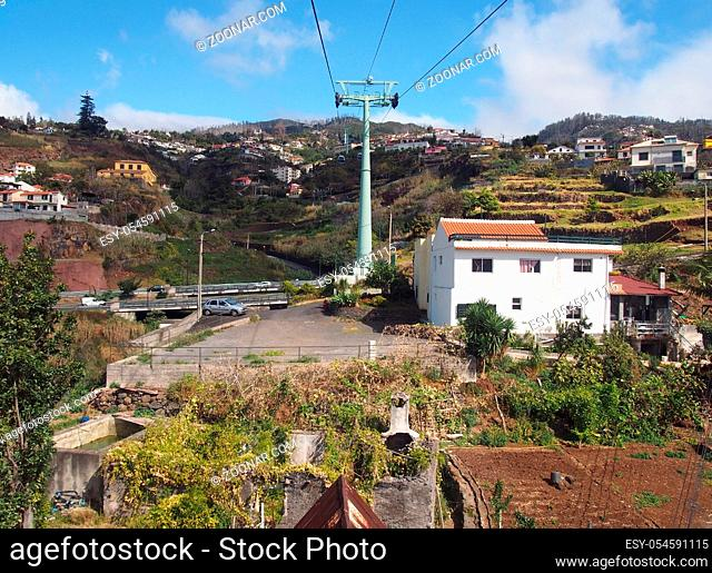 view of the of houses and market gardens of monte from the cable car running up the mountain from funchal