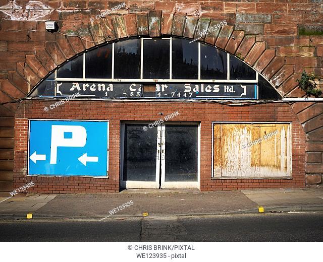 Closed down garage under railway arch in Manchester, UK