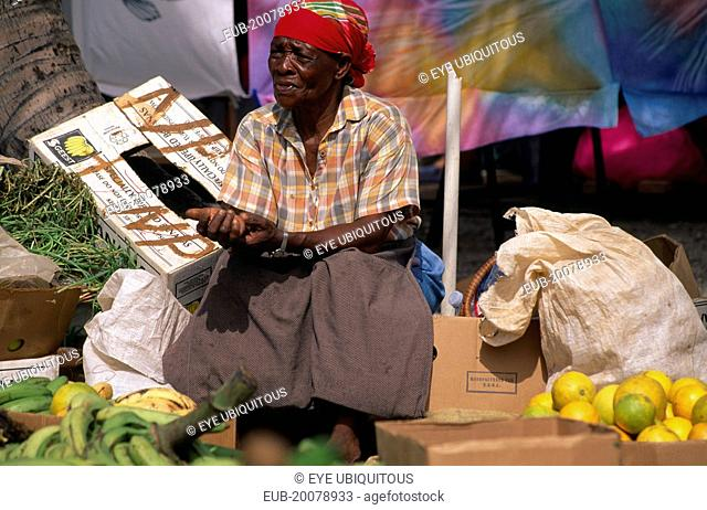 Woman stallholder in fruit and vegetable market