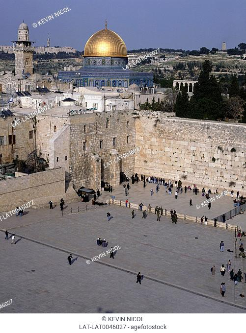 Temple Mount sacred site with Al Aksar Muslim mosque and the gold dome,and the Wailing Wall with Jewish people praying