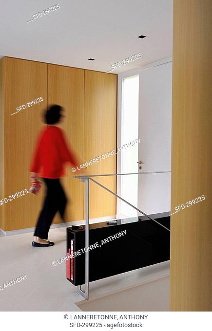 Woman walking through room Villa Bamboo, Southern France
