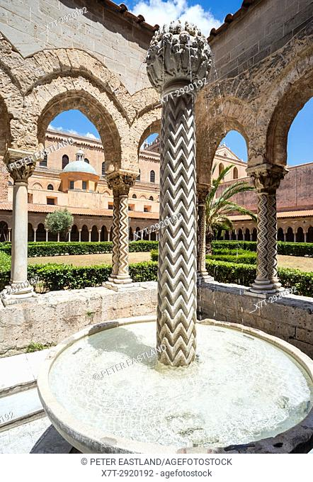 Decorated columns and fountain in the Lavatorium at The Chiostro dei Benedettini, cloisters, in the cathedral complex at Monreale near Palermo, Sicily, Italy