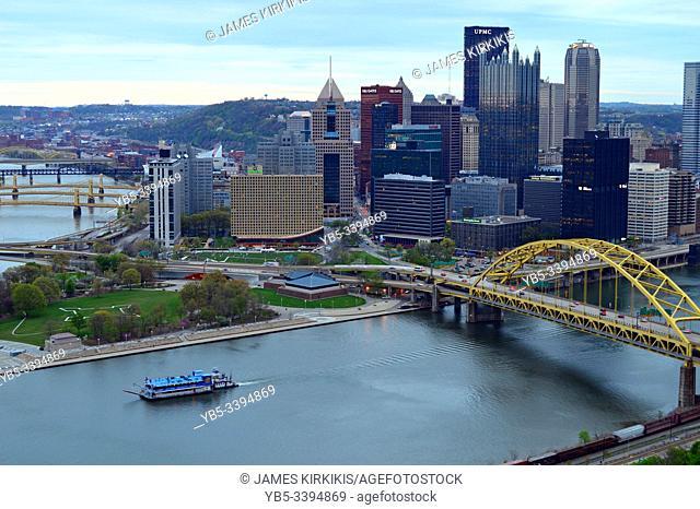 A tourist paddleboat cruises the rivers near Pittsburgh, Pennsylvania