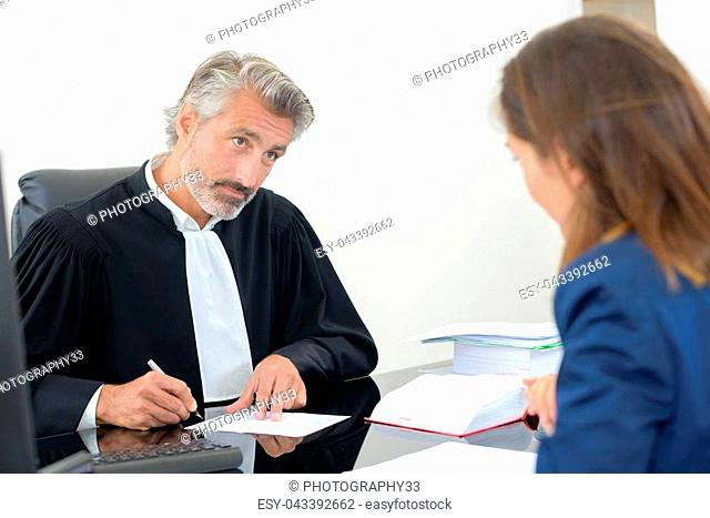 law staff with a client