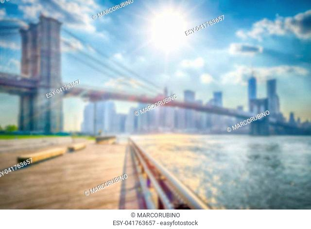 Defocused background of the Brooklyn Bridge in New York City. Intentionally blurred post production for bokeh effect