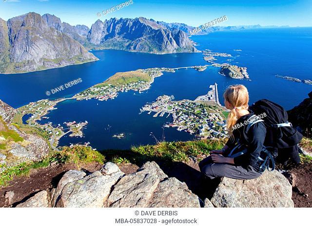 Young woman, view, Reine (village), fjord, Moskenesoya, Lofoten, Norway, Europe